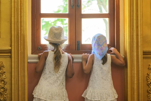two girls waiting at the door
